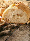 Loaf of homemade freshly baked bread and wheat ears Royalty Free Stock Images
