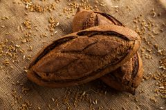 Loaf of homemade bread on sackcloth with rye. Royalty Free Stock Image