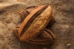 Loaf of homemade bread on sackcloth with rye. Stock Photo