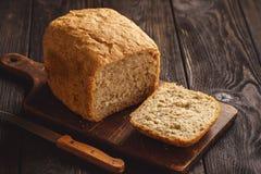 Loaf of homemade wholegrain bread. Loaf of homemade wholegrain bread stock image