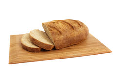 Loaf of Homemade Wholemeal Bread Over White Royalty Free Stock Photography