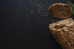Loaf of multi-grain bread, cut into sandwiches. Close-up, free space for text. Stock Photos