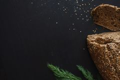 Loaf of multi-grain bread, cut into sandwiches. Close-up, free space for text. Royalty Free Stock Photography