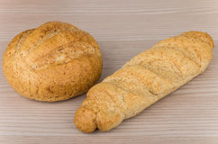 Loaf and round fresh buckwheat bread on table Stock Photography