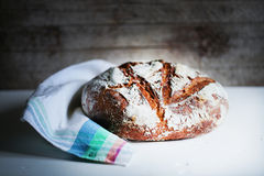 Loaf of rye artisan sourdough bread, rustic kitchen Stock Image