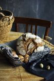Loaf of rye bread in a basket with chicken eggs on the table. The Loaf of rye bread in a basket with chicken eggs on the table Royalty Free Stock Images