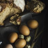 Loaf of rye bread with chicken eggs in wooden box. The Loaf of rye bread with chicken eggs in wooden box Royalty Free Stock Image