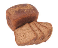 Loaf of rye bread and four slices Stock Photo