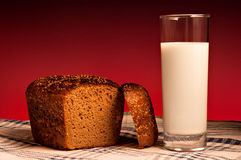 A loaf of rye bread and a glass of milk Stock Image