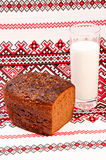 A loaf of rye bread and a glass of milk Stock Photos