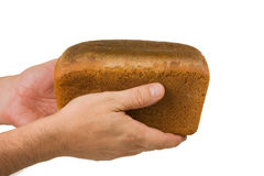 Loaf of rye bread in his hand Royalty Free Stock Images