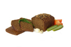 Loaf of rye bread served with vegetables Royalty Free Stock Image
