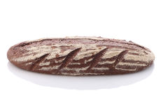 Loaf of rye bread on a white background Stock Images