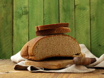 Loaf of rye bread on a wooden table Royalty Free Stock Photo