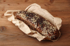 Loaf of rye unleavened  bread without yeast sprinkled sesame Stock Image