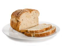 Loaf of sliced bread on plate. Royalty Free Stock Image