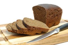 Loaf of sliced grain bread Stock Image