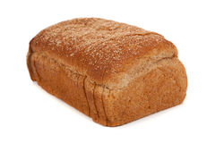 A loaf of sliced wheat bread on white Royalty Free Stock Photo