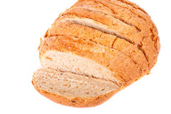 Loaf of Sliced Whole Grain Bread on White Stock Photography
