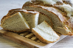 Loaf and slices of bread Stock Photos