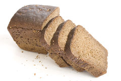 Loaf and slices bread on white background. Loaf and slices of black bread with carum on white background Stock Photo