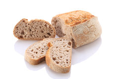 Loaf and slices of bread on a white background Stock Photo