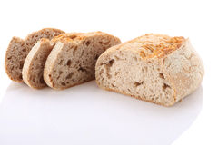 Loaf and slices of bread on a white background Royalty Free Stock Photography