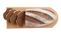 Loaf and slices of rye bread on a cutting boards isolate Royalty Free Stock Image