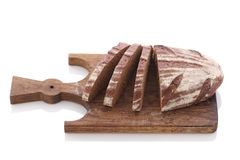 Loaf and slices of rye bread on a cutting boards isolate Stock Photos