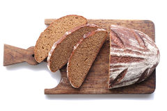 Loaf and slices of rye bread on a cutting boards isolate Stock Image
