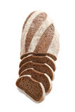 Loaf and slices of rye bread on a white background Stock Photo