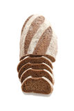 Loaf and slices of rye bread on a white background Royalty Free Stock Photo