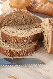 Composition with cut brown bread close up stock photo