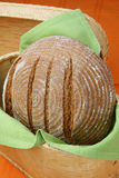 Loaf of spelt bread. On plate Stock Photos