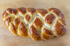 Loaf of sweet braided bread on Table Royalty Free Stock Photos