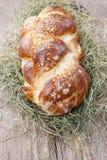 Loaf of sweet christmas bread lying on hay Stock Photo