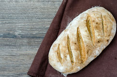 Loaf of traditional rustic bread on wooden background Stock Photos