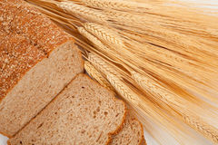 Loaf of wheat bread and shocks of wheat. A loaf of wheat bread and shock of wheat Stock Photos