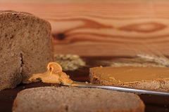 Loaf of  wheat,rye bread, sliced bread with peanut cream Royalty Free Stock Photo