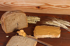 Loaf of  wheat,rye bread, sliced bread with peanut cream Stock Photography