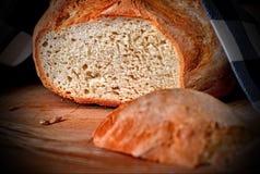Loaf of wheaten bread. Sliced wheaten bread on cutting board. Closeup. Selective focus. stock image