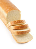 Loaf of white bread. A loaf of white bread, sliced, isolated on white Stock Photos