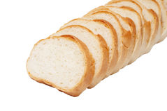 Loaf of white bread cut into pieces Royalty Free Stock Image