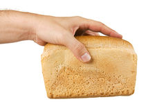 Loaf of white bread in hand Royalty Free Stock Images