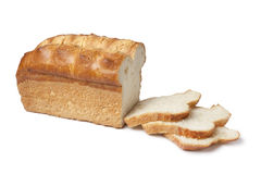 Loaf of white bread with slices Royalty Free Stock Images