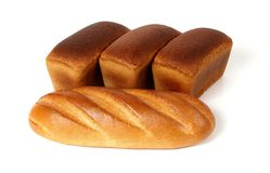 Loaf of white bread and three loaves of rye bread Royalty Free Stock Photos