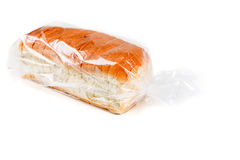 Loaf of whole grain bread in a bag. Isolated on white background stock photos