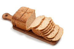 Loaf of whole grain bread on a board Royalty Free Stock Photo