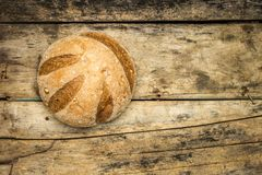 Loaf of whole wheat grains bread on wood background Stock Photography