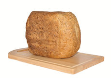 Loaf of Wholegrain Bread on Breadboard. Stock Photos